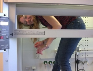 Jenny inside fumehood before she quit science to travel