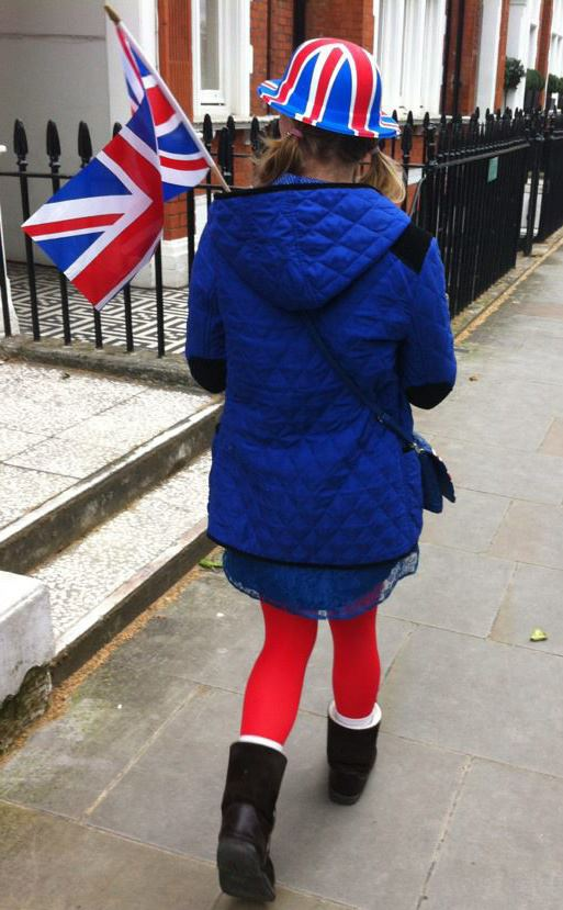 Jenny dressed up in Union Jack and british colours holding a flag
