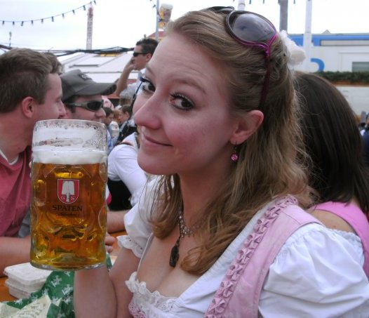 Jenny in her German dress holding a stein of german beer